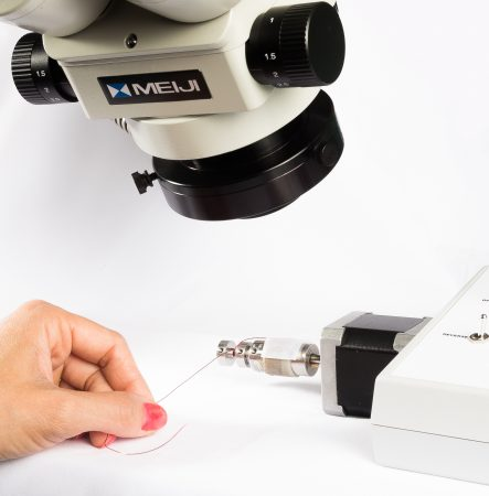 Manufacturing eddy current probes under microscope