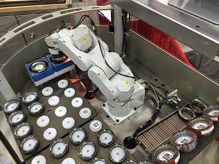 Robotic work cell sorting gears for proper heat treat
