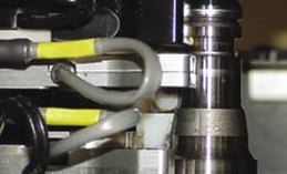 Close up view of eddy current probe performing crack test on a bearing spindle