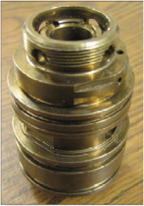 Fuel injector housing to be eddy current tested by a manufacturer of diesel engines